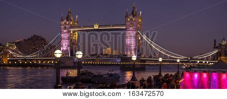 LONDON, UK - DECEMBER 29TH 2016: A night-time panorama of a beautifully illuminated Tower Bridge in London UK, on 29th December 2016.