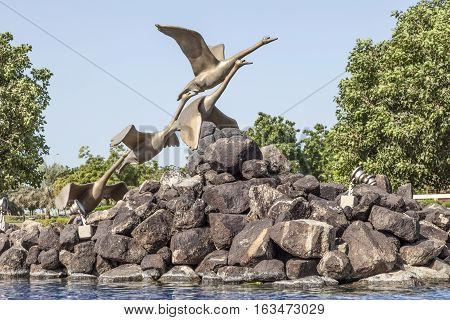 Swans sculpture at the corniche park in Abu Dhabi United Arab Emirates