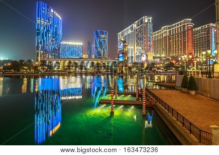 Macau, China - December 8, 2016: Luxury resort Casino in Cotai Strip, Crown Towers, City of Dreams, Hard Rock, St Regis, Holiday Inn, Conrad, Sheraton, reflecting on lake of The Venetian by night.