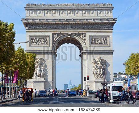 PARIS, FRANCE OCTOBER 19: Triumphal Arch de l Etoile ( arc de triomphe) . The monument was designed by Jean Chalgrin in 1806 in Paris, France on October 19, 2014
