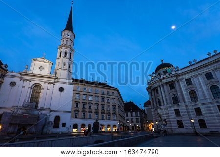 Famous hofburg palace and church in vienna in the evening seen from michaelerplatz austria
