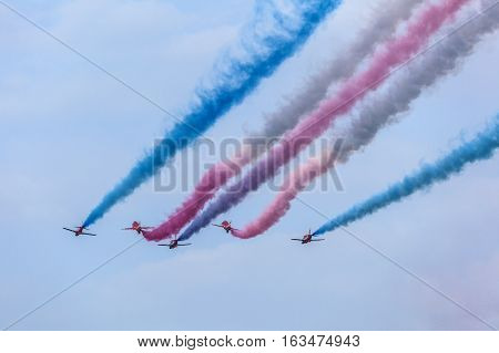 ABU DHABI UAE - NOV 24 2016: Royal Air Force Aerobatic Team Red Arrows performs in an airshow over the Abu Dhabi Corniche