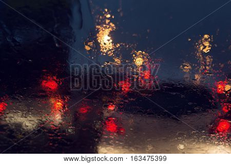 Traffic Jam In Heavy Rainy Day On City Street At Night, Abstract Blur Image Defocused Background
