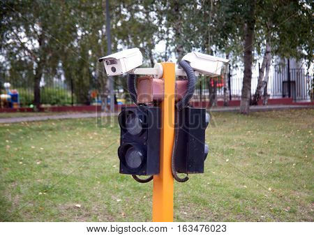 Access control system, consisting of video cameras and traffic lights outdoors closeup