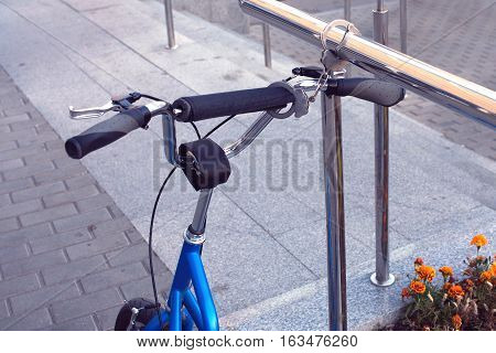 Steel handcuffs as bicycle theft protection. Photo closeup