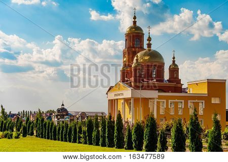 STROITEL BELGOROD REGION RUSSIA - JULE 02 2016: District center in the Belgorod region. Alley overlooking on the city prosecutor's office and current Orthodox church in honor of the New Martyrs and Confessors of Belgorod.