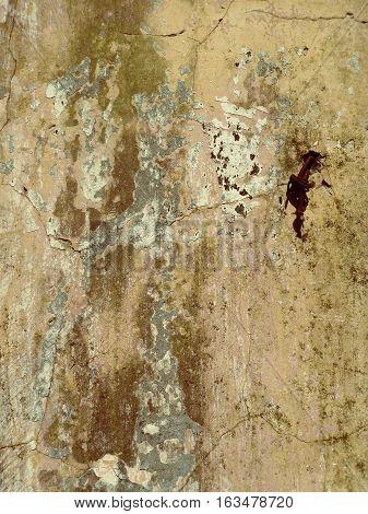 Fragmento de pared con manchas de humedad y pintura