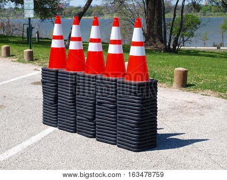 New traffic cones are unloaded in a parking lot. Traffic engineering was waiting in the wings to put them to good use.