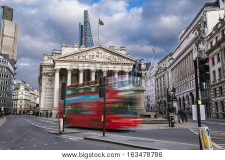 London England - The Royal Echnage building with moving red double decker bus on the move