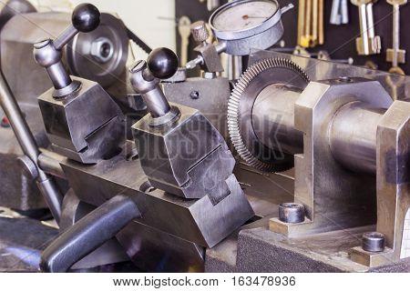 Key copying machine in a workshop. Close up.