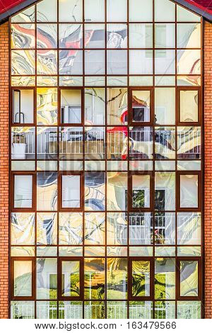 Translucent stained-glass window of the new apartment building with abstract reflection
