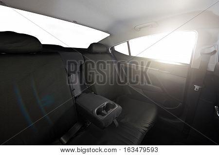 Cloth back black seat of modern sedan car with isolated windows