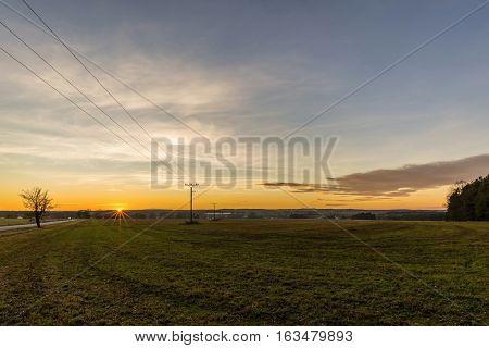 Evening Scene Of Autumn Field With Sunset