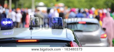 Police Patrol Car  And A Police Car Undercover During The Event In The City