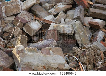Bricks in a dumpster near a construction site home renovation