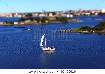Boat floating at the Baltic Sea, Karlskrona, Sweden. Tilt-shift method