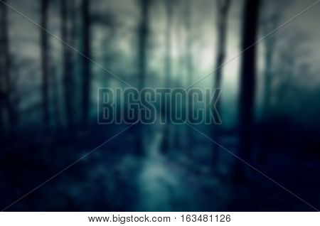Dark and scary blurred background with forest: for web usage