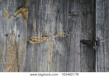 Black wood background. Unpainted wood with knots.