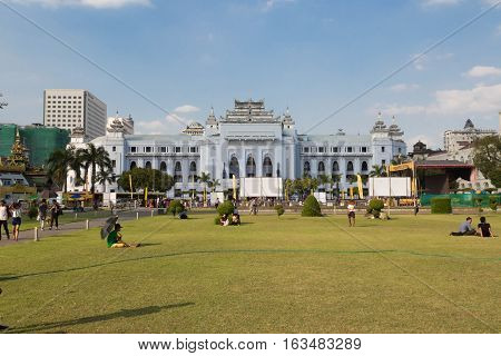 YANGON MYANMAR - NOVEMBER 26 2016: The withe palace of Yangon City Hall is centrally located and it has been the focal point of several major political demonstrations.