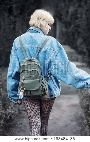 Rear View Of Alternative Styled Girl Walking In The Nature