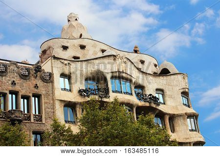 BARCELONA, SPAIN - OCTOBER 08, 2013: Casa Mila or La Pedrera in Barcelona, Spain. This famous building was designed by Antoni Gaudi and is one of the most visited of the city