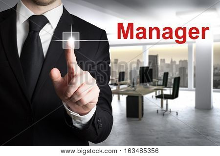 businessman in modern office pushing button manager