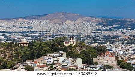 Agia Marina or Saint Marina orthodox church and the National Observatory on the Hill of the Nymphs in Athens Greece