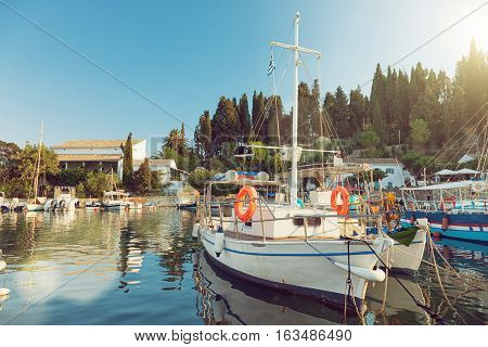 Colorful fishing boats docked in the harbor of Kalami Corfu island Greece