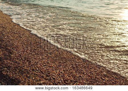 Surf on pebble beach, Olkhon island, lake Baikal, Russia