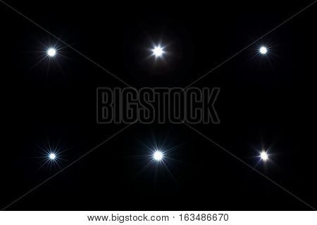 Set of flash lights with lens flare effect on black background