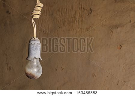 old burnt bulb against a background cracked wall, Breakage, old, decay, abandoned house
