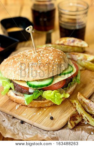 Beef hamburger with whole wheat buns vegetables and french fries