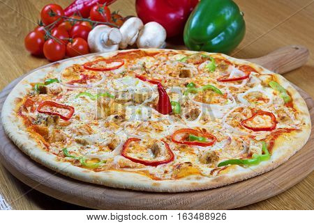 Pizza with Chicken Breast, mushroom and Mozzarella Cheese on wooden background
