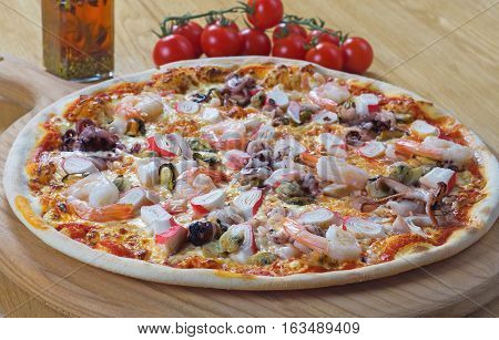 Seafood Italian Pizza on wood dish originality
