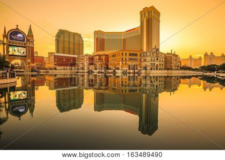 Macau, China - December 8, 2016: scenic landscape of iconic The Venetian Macau mirrored on the lake at sunset, the largest casino in the world and the largest single structure hotel building in Asia.