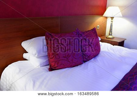 wide double bed in the hotel room