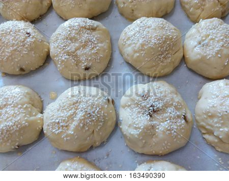 Homemade cheese buns of pastry sprinkled with sesame seeds
