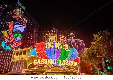 Macau, China - December 8, 2016: the neon lights of Casino Lisboa facade, one of the oldest and most famous casinos in Macau since 1970, other than the Grand Lisboa Casino that is newly built.