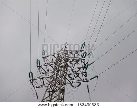City power line pillar on the background of gloomy sky