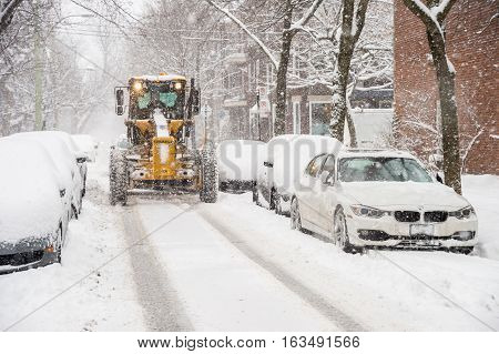 Montreal CA - 5 December 2016: A snowplow in motion during snow storm.