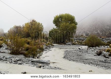 Water flowing through a flood wash after a heavy rainfall taken at the desert in Whitewater, CA