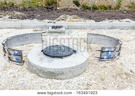 New manhole with disassembled demountable the metal mold.