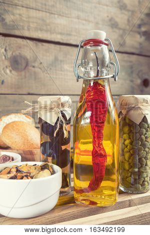 Bottle Of Olive Oil With Chilli. Mediterranean Food.