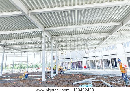 View from below on new ceiling; pillars with steel joints are painted in white.