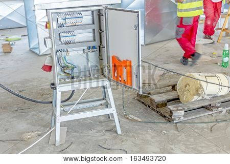 Electrical cabinet with connectors is providing electrical energy to construction site.