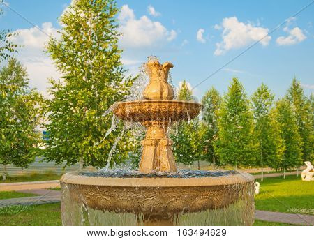 Fountain with splashes and jets of water in a city park