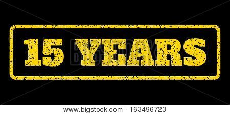 Yellow rubber seal stamp with 15 Years text. Vector tag inside rounded rectangular banner. Grunge design and dust texture for watermark labels. Horisontal emblem on a blue background.