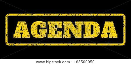 Yellow rubber seal stamp with Agenda text. Vector message inside rounded rectangular banner. Grunge design and scratched texture for watermark labels. Horisontal sticker on a blue background.
