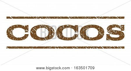 Cocos watermark stamp. Text caption between horizontal parallel lines with grunge design style. Rubber seal stamp with scratched texture. Vector brown color ink imprint on a white background.