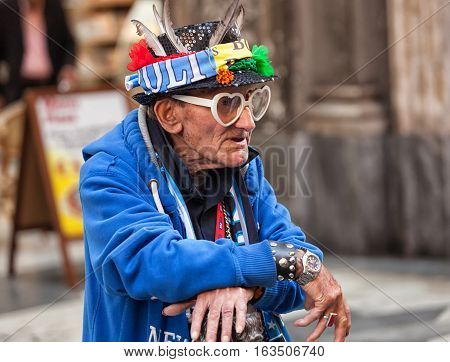 Elder Napoli Fan With Goggles And Amulets.